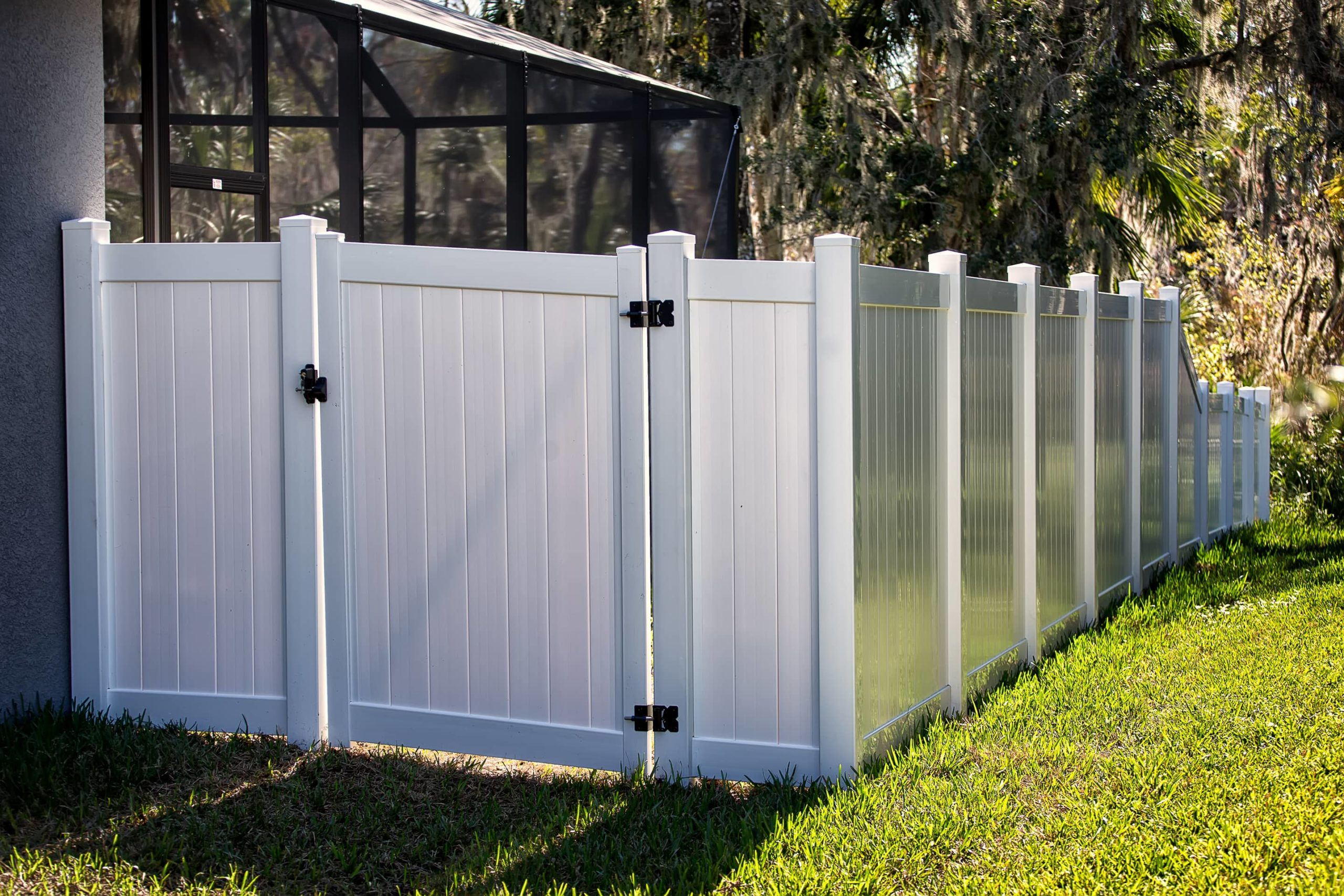 This is an image of a white plastic fence with a gate that opens.